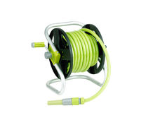 Hose coiled with spray nozzle Royalty Free Stock Photo