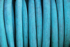 Hose. Curled blue dirty hose closeup royalty free stock images