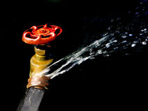 Hose Faucet Connection Leaking and Squirting Water Royalty Free Stock Image