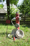 Hose and hydrant Stock Images
