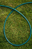 Hose loop. A loop of hose on green grass Stock Photography