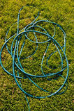 Hose pipe on garden grass Royalty Free Stock Photography