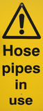 Hose pipe warning sign Stock Photos
