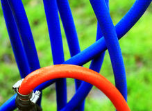 Hose pipes. Blue and red hose pipes Royalty Free Stock Image