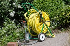 Hose on reel used for irrigation Royalty Free Stock Image