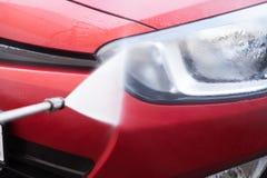 Hose Splashing Water On Car Headlight Royalty Free Stock Photo