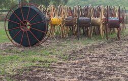 Hose spools on a lawn Stock Photo