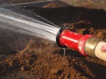 Hose Spraying Water on Ground - Horizontal Royalty Free Stock Image