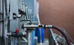 Hose and valve leading from wine storage tank at Maxwell Wines, McLaren Vale, South Australia Stock Photos