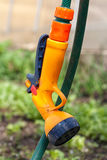 Hose for watering the garden. With the spray stock photos