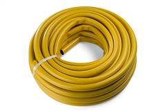 Hose for watering yellow color. Garden hose in a skein. Isolated on a white background royalty free stock photography