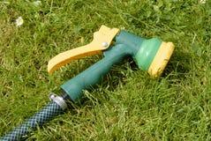 Hosepipe trigger. Closeup of a hosepipe nozzle stock photos
