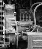 Hoses, engine and spare parts inside the hood of the tractor Stock Image
