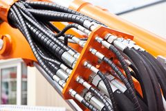 Hoses of hydraulic machine. Hoses of modern hydraulic machine stock image