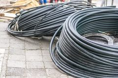 Hoses on the street during urban renovation Stock Photos