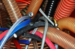Hoses and tubes. Several coloured plastic and metal hoses and tubes in a box Stock Image