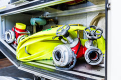 Hoses in vehicle of german fire brigade. Fire hoses and connections in truck of fire brigade stock image