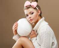 Hosiery. Beautiful Teen in Handmade Woven Sweater with White Ball of Yarn Royalty Free Stock Photo