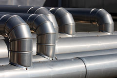 Hosing industrial. Three industrial iron/aluminum hoses for the transport of hot and cold water Royalty Free Stock Photos