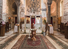 Hosios Loukas Monastery. The golden religious paintings and an altar with candles and chandelliers at the interior of Hosios Loukas Monastery in Boetia, Greece Royalty Free Stock Images