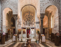 Hosios Loukas Monastery. The golden religious paintings and an altar with candles and chandelliers at the interior of Hosios Loukas Monastery in Boetia, Greece Stock Photography