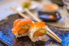 Hosomaki sushi and chopstick Stock Photos