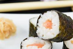 Hosomaki - Sushi. Hosomaki - Japanese small sushi rolls. Kappamaki (filled with cucumber) and Sakemaki (filled with salmon) served with wasabi and gari Royalty Free Stock Photography