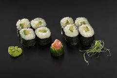 Hosomaki sushi rolls with avocado decorated with wasabi Stock Images