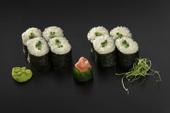 Hosomaki sushi rolls with cucumbers decorated. With wasabi and seaweed salad Royalty Free Stock Photography