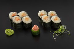 Hosomaki sushi rolls decorated with wasabi. And seaweed Stock Images