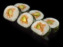 Hosomaki sushi with smoked salmon. Avocado and rice Stock Photo