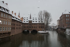Hospice of the Holy Spirit on the Pegnitz river canal in winter time. Nuremberg. Bavaria. Germany. Stock Photos