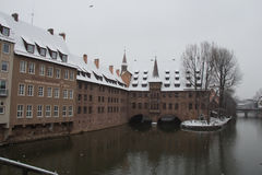 Hospice of the Holy Spirit on the Pegnitz river canal in winter time. Nuremberg. Bavaria. Germany. Stock Photo