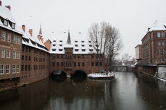 Hospice of the Holy Spirit on the Pegnitz river canal in winter time. Nuremberg. Bavaria. Germany. Royalty Free Stock Image