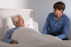 Hospice patient with a caregiver Royalty Free Stock Images