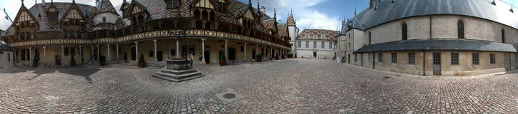 Hospices de Beaune. Panorama of the famous Hospice de Beaune (also called Hotel Dieu) in Burgundy, France. This place used to be a hospital for poor people Royalty Free Stock Images