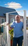 Hospitable adult man near gate Stock Photos