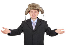 Hospitable funny man with a fur hat Royalty Free Stock Photos