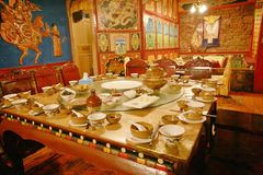 Shangri-La. Hospitable Tibetans will entertain guests in the hall at major festivals. Now Tibetans use it as a Hotel Familia to receive visitors Stock Image