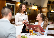 Hospitable waitress taking order Stock Image