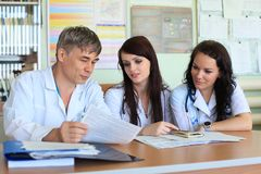 Hospital. Medical theme: doctors are studying a medical report Royalty Free Stock Photo