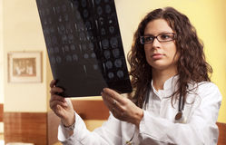 Hospital. Young female doctor examines a radiogram Stock Images