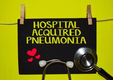 HOSPITAL ACQUIRED PNEUMONIA on top of yellow background. A stethoscope and blackboard with word HOSPITAL ACQUIRED PNEUMONIA on top of yellow background. Medical stock photography