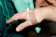 At the Hospital: Bandage Hand Stock Photo