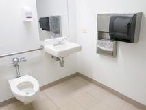 Hospital Bathroom. Clean public hospital bathroom with handrail soap and paper towel dispenser royalty free stock images