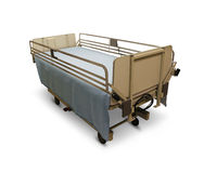 Hospital Bed. Or medical stretcher on a white background as a health care symbol of patient needs and surgery recovery with side rails and an adjustable height Royalty Free Stock Photos