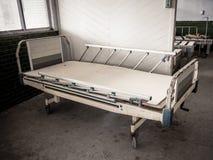 Hospital bed at abandoned asylum. Hospital bed at abandoned mental hospital royalty free stock image