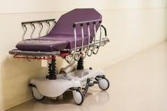 Hospital bed in hallway stock photos