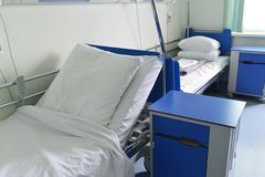 Hospital beds in hospital ward Royalty Free Stock Images