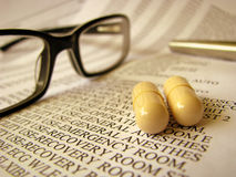 Hospital Bill And Medicine. Closeup Of A Medical Hospital Bill, Medicine And Glasses Royalty Free Stock Image